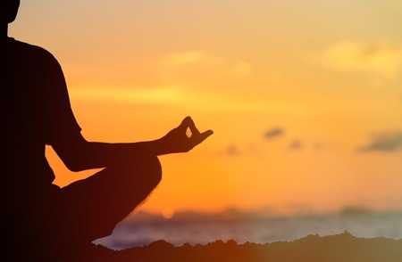 serenity and yoga practicing at sunset, meditation Stock Photo