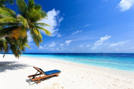 white sand beach: Beach chair on perfect tropical white sand beach
