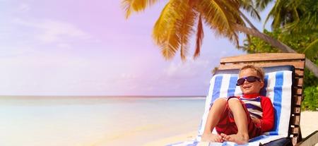 beach panorama: little boy relaxed on summer tropical beach, panorama