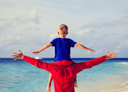 fun day: happy father and little son on shoulders play on sky Stock Photo