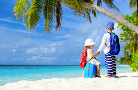guy on beach: little boy and girl travel on summer tropical beach, family vacation Stock Photo
