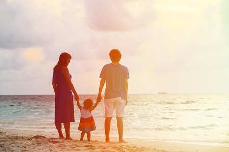 together: Happy family together at sunset. Mother, father and little child