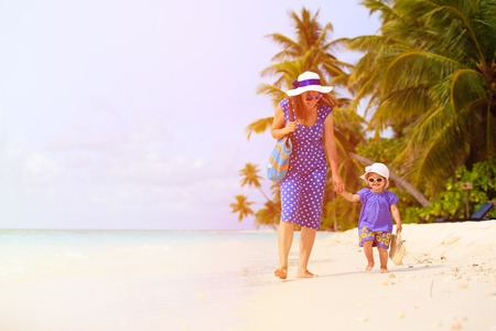 daugther: mother and cute little daugther walking on tropical beach Stock Photo