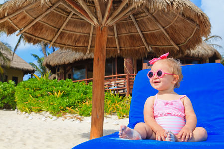 cute little girl on summer beach vacation Stock Photo