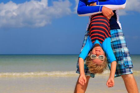 vacation: little boy having fun with dad on summer beach vacation Stock Photo