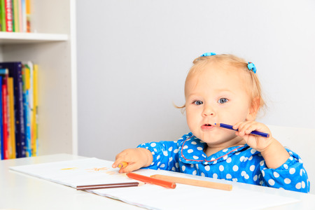early learning: little girl with pencils, early learning concept