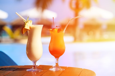 tropical paradise: Two cocktails on luxury tropical beach resort