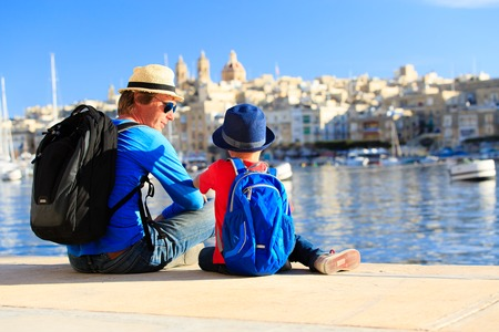 father and son looking at city of Valetta, Malta, family travel Stok Fotoğraf