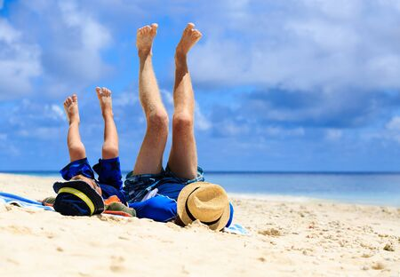 family vacation: father and son having fun on the beach, family vacation Stock Photo
