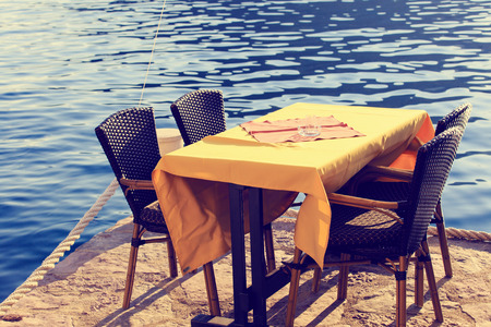 romantic beach: served scenic cafe table near the sea Stock Photo