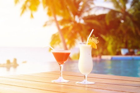 refreshment: Two cocktails on luxury tropical beach vacation Stock Photo