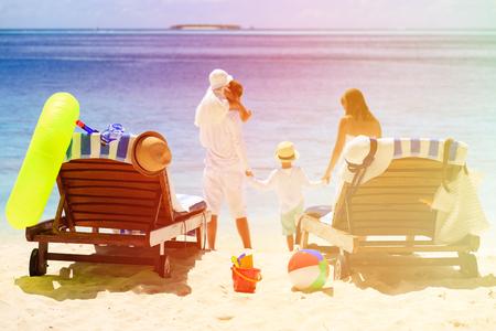sand toys: chairs on tropical beach, family beach vacation concept