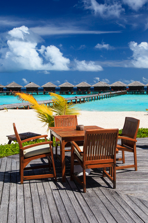 unspoilt: cafe on beach resort, luxury tropical vacation Stock Photo