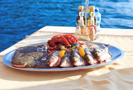 mediterranean cuisine: fresh seafood plate in restaurant near the sea Stock Photo