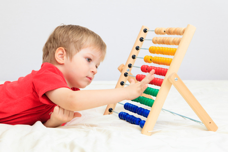 early learning: little boy playing with abacus, early learning