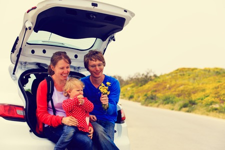 flower fields: family with cute little daughter travel by car in nature Stock Photo