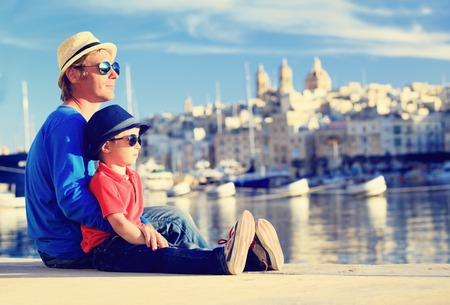 father and son looking at city of Valetta, Malta, family travel Stockfoto