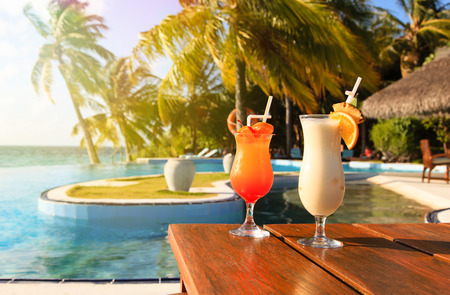 exotic fruits: Two cocktails on  luxury tropical beach resort Stock Photo