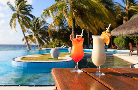 pool party: Two cocktails on  luxury tropical beach resort Stock Photo