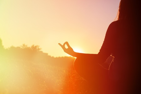 serenity and yoga practice in autumn park at sunset 写真素材