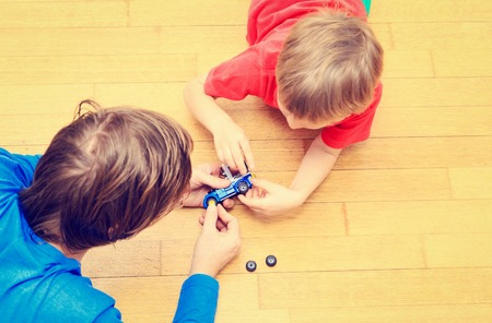 top down car: ather teaching son how to repair toy car, kids learning