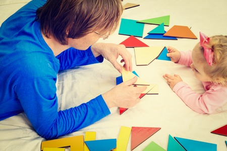 early learning: teacher and child playing with geometric shapes, early learning