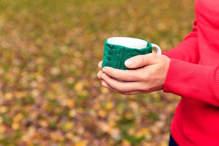 nostalgia: woman holding cup of tea or coffee in autumn fall, autumn nostalgia Stock Photo