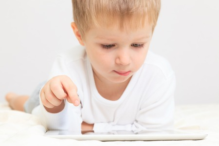 Little boy with touch pad, early education and modern technology Archivio Fotografico