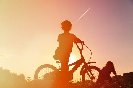 little boy riding bike at sunset, active kids sport