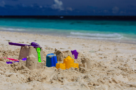 plastic scoop: kids toys on tropical sand beach, kids at beach Stock Photo