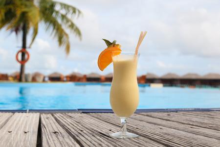pina: pina colada cocktail on tropical beach resort