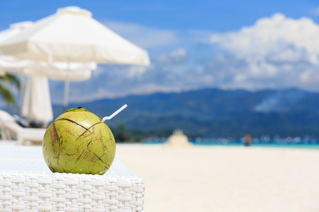 resort beach: coconut drink on tropical sand beach resort