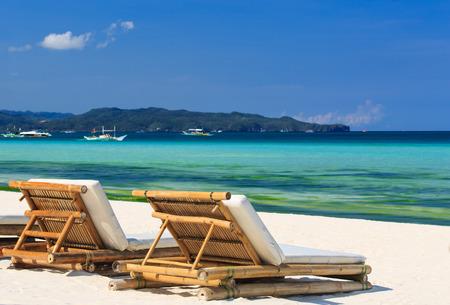 white sand beach: Beach chairs on perfect tropical white sand beach Stock Photo