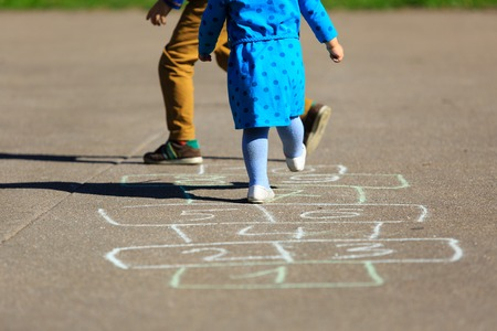 outdoors: kids playing hopscotch on playground outdoors, children outdoor activities