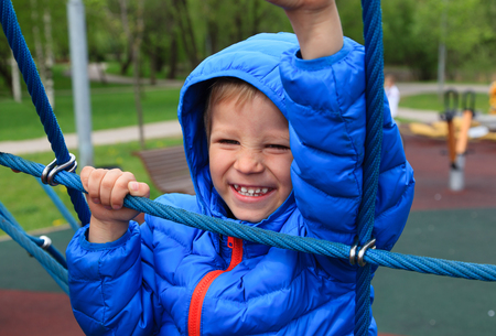 early learning: happy child climbing rope on the playground, early learning