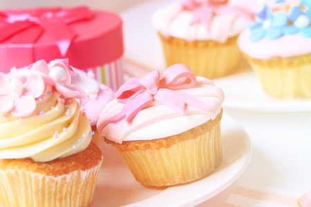 cup cakes: delicious dessert table served for big party Stock Photo