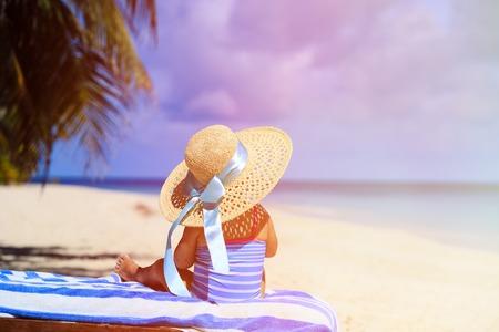 cute little girl smiling: little girl in big hat on summer tropical beach