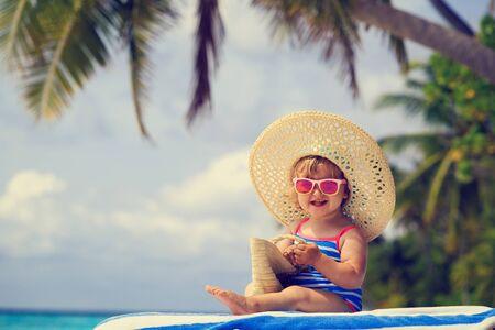 little girl beach: cute little girl in big hat on summer tropical beach