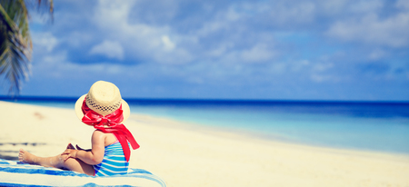 big girl: little girl in big hat on summer tropical beach, wide panorama