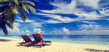 sunny beach: Two beach chairs on the tropical sand beach, panorama ideal for banners