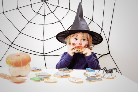 trick or treating: cute little girl in halloween costume, kids trick or treating Stock Photo
