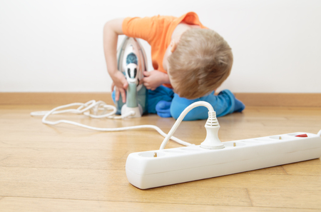 protect home: child playing with electricity, kids safety concept