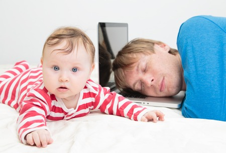 interst: father tired of working from home- parent sleeping on laptop while baby crawling