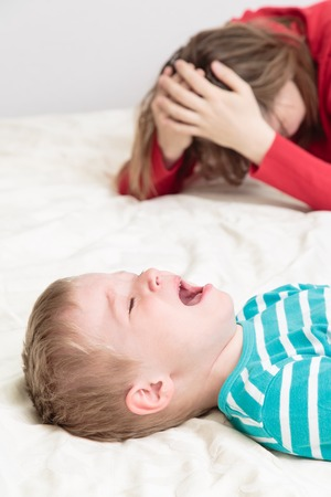 disobedient: child is crying whild mother is tired, difficult parenting