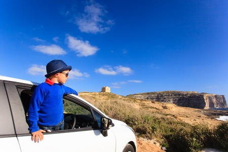 happy little boy travel by car on summer vacation, kids travel