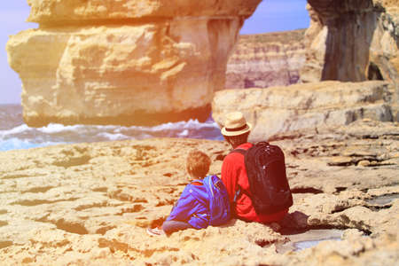 azure: father and son looking at scenic mountains, family travel