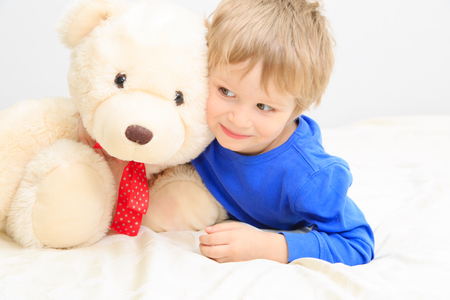 playtime: cute little boy with teddy bear, kids playtime
