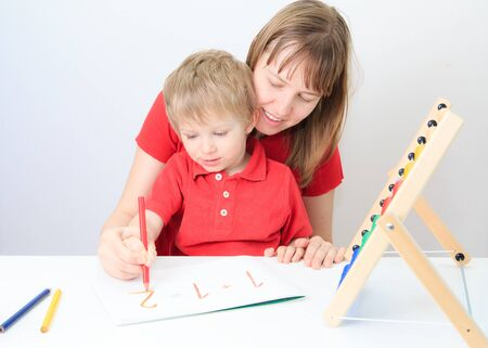 early education: mother and son learning math, early education Stock Photo