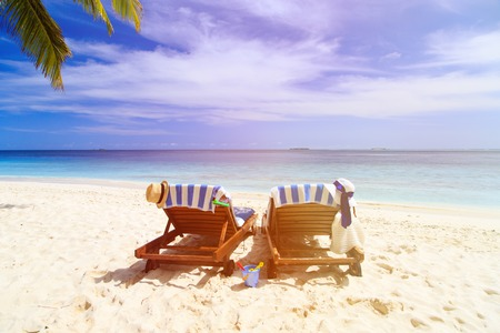 lounge chair: Two beach chairs on the tropical sand beach