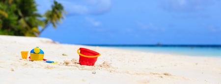 beach panorama: kids toys on summer white sand beach, panorama